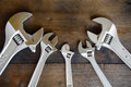 Spanner Or Adjustable Wrench On Wooden Back Ground, Basic Hand Tools Stock Images - 51265904