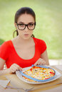 Surprised Woman Measures Pizza With Measure Tape Royalty Free Stock Photography - 51266487