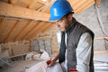 Construction Manager Looking At  Blueprint Royalty Free Stock Photos - 51284878
