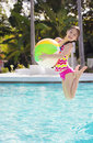 Cute Girl Playing And Jumping In The Swimming Pool Stock Photo - 51287660