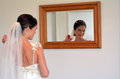 Bride Looks At Herself In The Mirror On Her Wedding Day Stock Image - 51306551