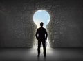 Business Man Looking At Keyhole With Bright Cityscape Concept Stock Photography - 51353562