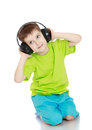 Little Boy Listening To Music Through Big Royalty Free Stock Photo - 51358075