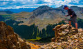 Standing On Edge Of Rocky Mountains Exploration Hiking Terrain Royalty Free Stock Photography - 51391947