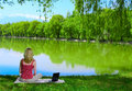 Beautiful Young Woman With Laptop Near The Lake Royalty Free Stock Photo - 5143335