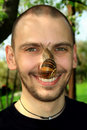 Portrait Of The Man With A Snail Stock Images - 5149464