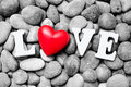 The Word Love With Red Heart On Pebble Stones Royalty Free Stock Photo - 51405995