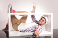 Happy Young Fashion Man Lying Inside Of A White Box Royalty Free Stock Photo - 51475915