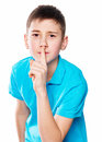 Portrait Of A Boy Pointing Finger Showing Emotions Expressive On A White Background With A Blue Shirt Stock Photos - 51479683
