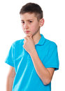 Portrait Of A Boy Pointing Finger Showing Emotions Expressive On A White Background With A Blue Shirt Stock Photos - 51479693
