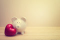 Piggy Bank With Red Heart Stock Photos - 51508633