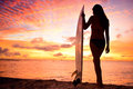 Surfer Girl Surfing Looking At Ocean Beach Sunset Royalty Free Stock Images - 51513989