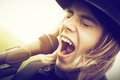 Young Man With Long Hair And Hat Singing To Microphone. Vintage, Music Royalty Free Stock Image - 51535466