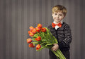 Little Child Boy Giving Flowers Bouquet, Handsome Kid Greeting R Stock Images - 51535704