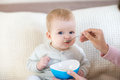 Baby Eating While Siting On The Bed Royalty Free Stock Images - 51538059