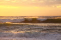Sea Waves Rolling By Golden Sky Stock Images - 51550934