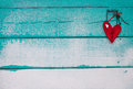 Red Wooden Broken Heart Hanging On Sandy Turquoise Sign Stock Photo - 51552440