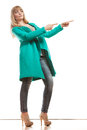 Woman In Green Coat Showing Copy Space Royalty Free Stock Images - 51600449