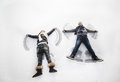 Boy And Girl Making Snow Angels Stock Photo - 51605250