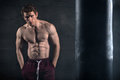 Athletic Man With Naked Torso Near Concrete Wall Stock Images - 51610474