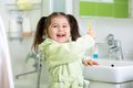 Child Brushing Teeth In Bathroom Stock Images - 51614044