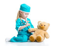 Child Girl With Clothes Of Doctor Playing Toy Royalty Free Stock Image - 51614156