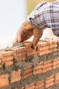 Bricklayer Working In Construction Site Of A Brick Wall Royalty Free Stock Photo - 51651415