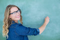 Smiling Geeky Teacher Writing On Blackboard Royalty Free Stock Images - 51652189
