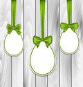 Easter Three Papers Eggs Wrapping Green Bows Royalty Free Stock Photos - 51656858