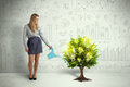 Business Woman Pouring Water On Lightbulb Growing Tree Stock Photo - 51672590