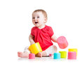 Funny Baby Playing With Colourful Cup Toys Royalty Free Stock Photography - 51677687