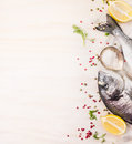 Raw  Dorado Fish With Multicolor Pepper,lemon An Spoon Of Salt On White Wooden Background, Top View Royalty Free Stock Image - 51702306