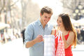 Couple Shopping And Holding Bags In The Street Royalty Free Stock Photo - 51724065