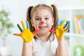 Five Year Old Girl With Hands Painted In Colorful Royalty Free Stock Photo - 51731025