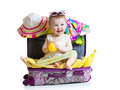 Baby Girl Sitting In Suitcase With Things For Royalty Free Stock Images - 51731349