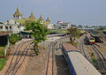 A Train Is Leaving The Yangon Central Railway Station On The Railway Tracks Stock Photos - 51760523