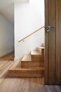 Modern Staircase Of Oak Wood Beside Front Door Royalty Free Stock Photography - 51769097