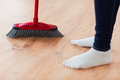 Close Up Of Woman Legs With Broom Sweeping Floor Royalty Free Stock Image - 51791646