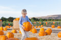 Kid At Pumpkin Patch Royalty Free Stock Image - 51801496