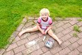 Preschooler Girl Drawing With Chalk Outdoors Royalty Free Stock Photos - 51805338