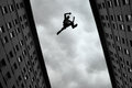 Man Jumping From Roof To Roof Royalty Free Stock Photography - 51812547