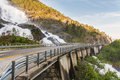Road In Norway Passing Over The Waterfall Langfoss Royalty Free Stock Images - 51842279