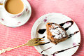 Piece Of Chocolate Cake And A Cup Of Coffee With Milk Stock Photo - 51849070
