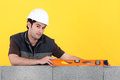 Builder With A Spirit Level Royalty Free Stock Photo - 51851995