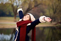 Girl Stretching Arms To Relax In Winter Royalty Free Stock Photos - 51859568