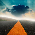 Long Road And Dramatic Sky With Sunray Stock Images - 51863974