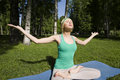 Blonde Real Girl Doing Yoga In Green Park On Grass Royalty Free Stock Photography - 51881897