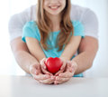Close Up Of Man And Girl Holding Red Heart Shape Stock Photos - 51885383