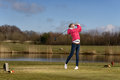 Woman Golfer Hitting A Golf Ball On The Fairway Royalty Free Stock Image - 51886456