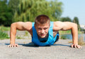 Handsome Young Man In Good Shape Doing Push-up While Outdoor Tra Royalty Free Stock Image - 51896826